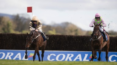Over the last: Bellshill (left) clears the final fence under David Mullins on the way to victory over Djakadam in the Coral Punchestown Gold Cup