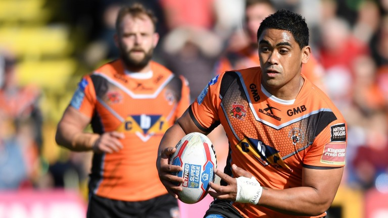 Junior Moors of Castleford moves the ball forward