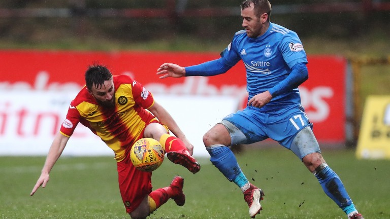 Steven Lawless of Partick Thistle (left) vies with Niall McGinn of Aberdeen