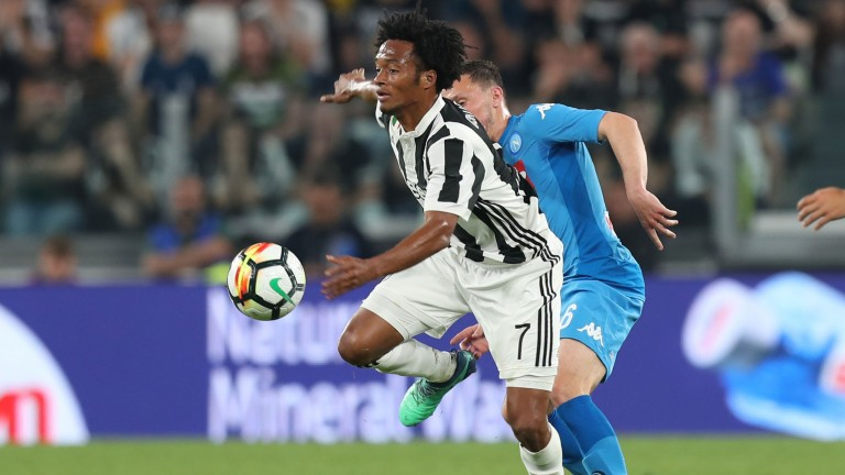 Juan Cuadrado of Juventus battles for the ball with Mario Rui of Napoli