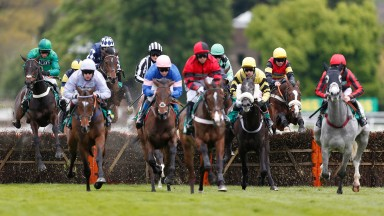 Runners stream over a flight of hurdles at Sandown on this day last year