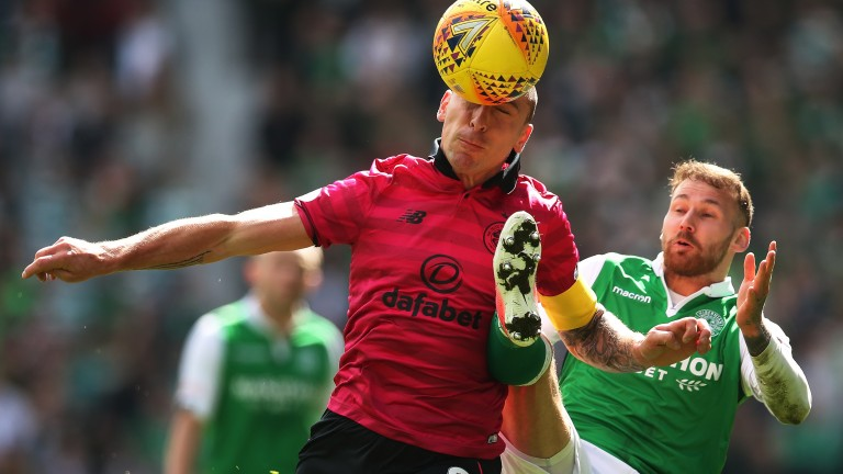 Scott Brown of Celtic controls the ball against Hibernian