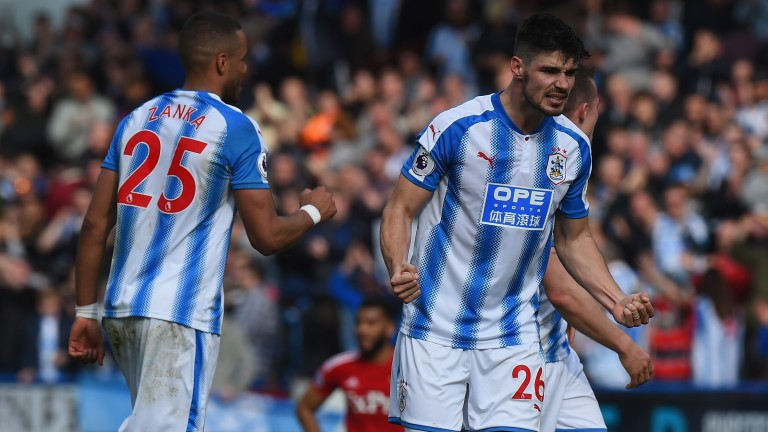 Huddersfield players celebrate their win over Watford