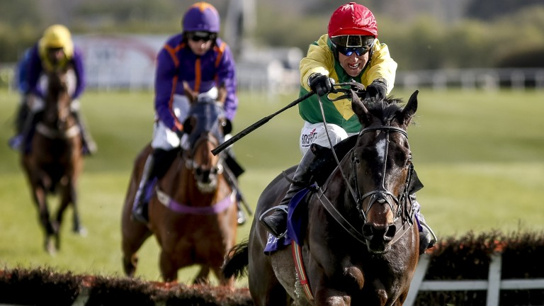 Robbie Power kicks for home on Supasundae, the pair clear from Wicklow Brave at the last