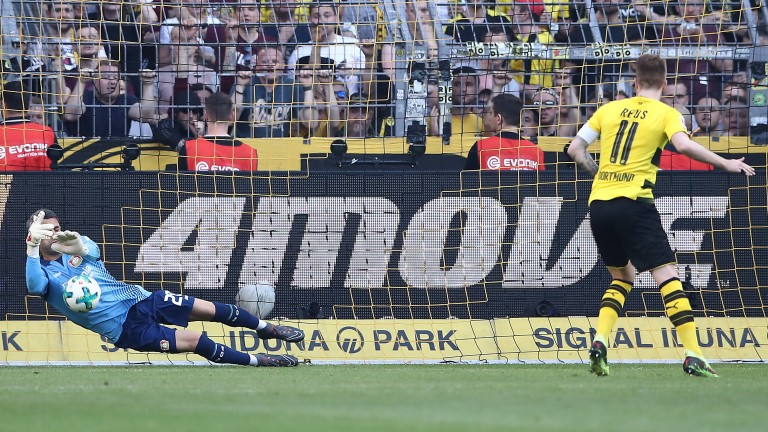 Marco Reus of Dortmund fires from the spot against Leverkusen