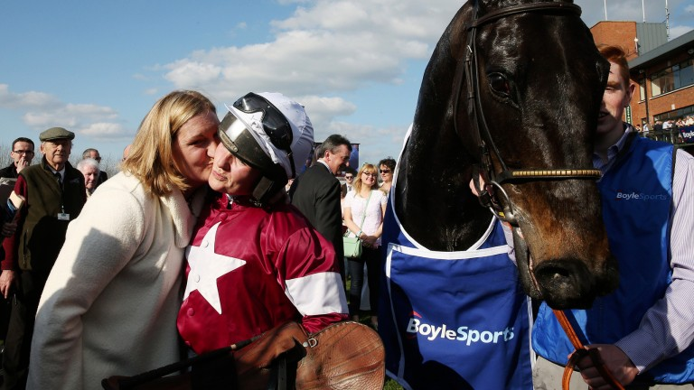 National winner: Katie Walsh receives a kiss from trainer Sandra Hughes after they teamed up to win the Irish Grand National with Thunder And Roses in 2015