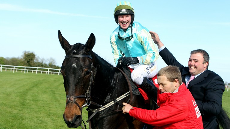 Sheer joy: Nina Carberry is greeted by her husband Ted Walsh jnr after winning the Irish Grand National on Organisedconfusion for Arthur Moore in 2011