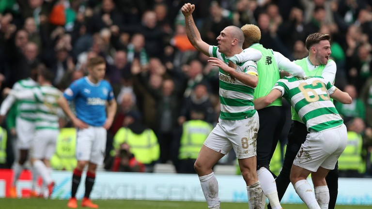 Scott Brown celebrates victory over Rangers with Celtic teammates