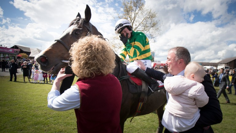 An emotional Nina Carberry with her husband Ted and daughter Rosie after riding her final winner aboard Josies Orders in the cross-country chase at Punchestown on Saturday
