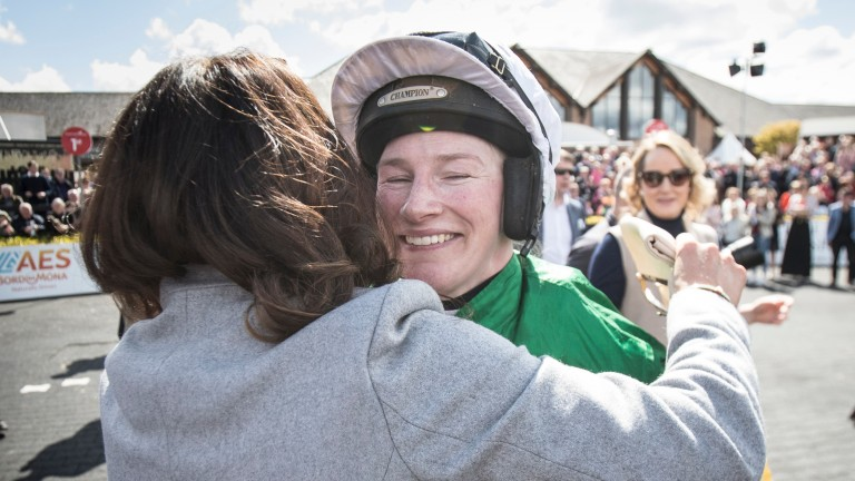 Nina Carberry is hugged by Katie Walsh after riding her last career winner when taking the Dooley Insurances Cross Country Chase with Josies Orders at Punchestown
