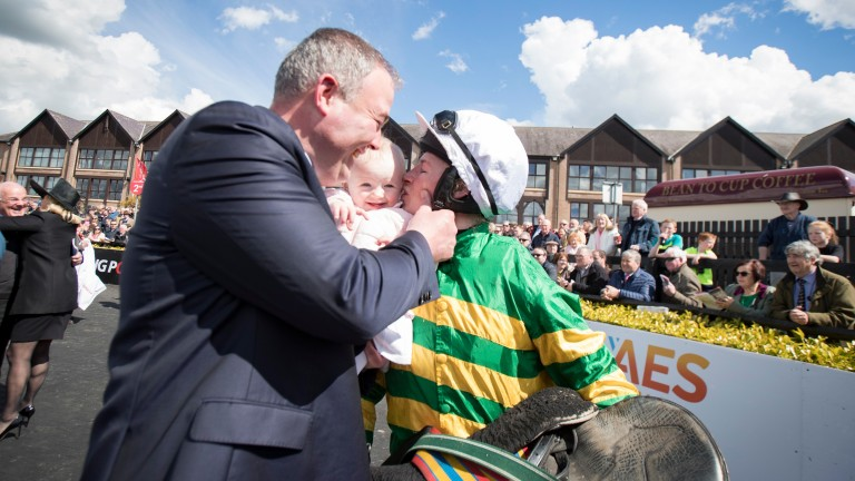 Family photo: Nina Carberry greets her daughter Rosie and husband Ted after announcing her retirement at Punchestown