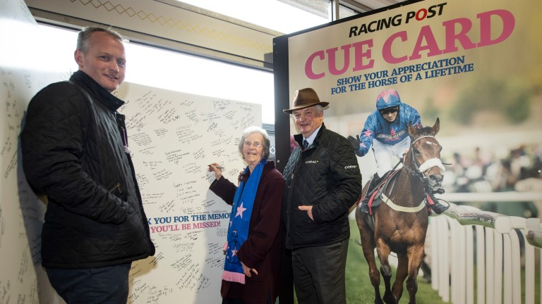 Star signatures: Joe Tizzard (left), Jean Bishop (middle) and Colin Tizzard sign the Racing Post's appreciation card for their popular chaser Cue Card