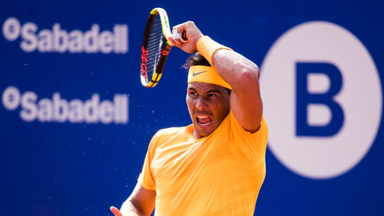 Rafael Nadal plays a forehand