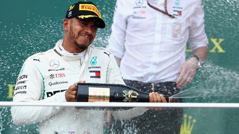 Lewis Hamilton celebrates on the Baku podium
