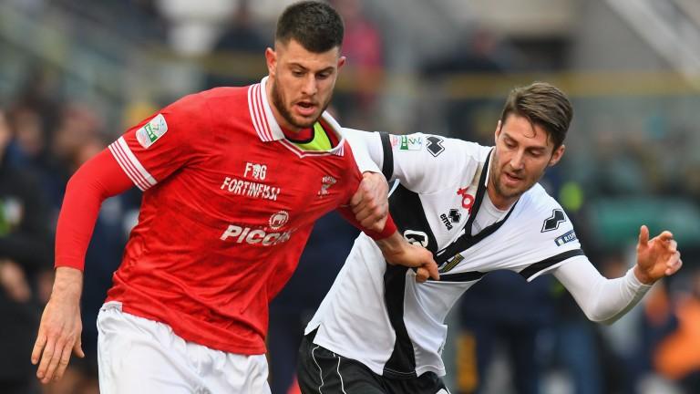 Perugia's Alberto Cerri (left) tussling with Parma's Manuel Scavone (right)