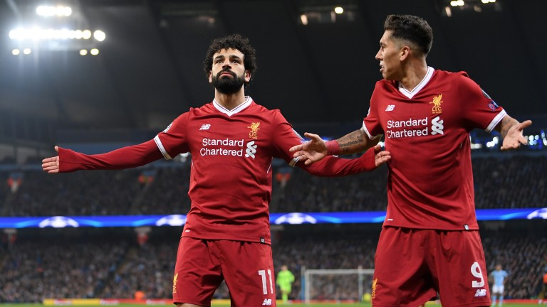 Mohamed Salah and Roberto Firmino celebrate after opening the scoring in the quarter-final against Manchester City