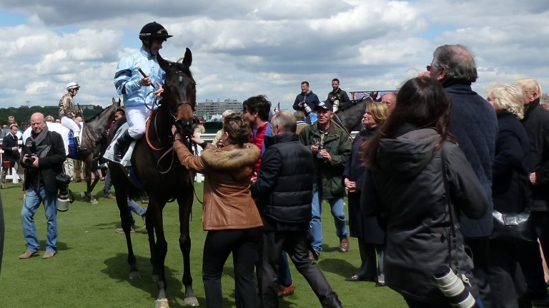 Olivier Peslier and Luminate return to a crowded Saint-Cloud enclosure after winning the Group 3 Prix Penelope