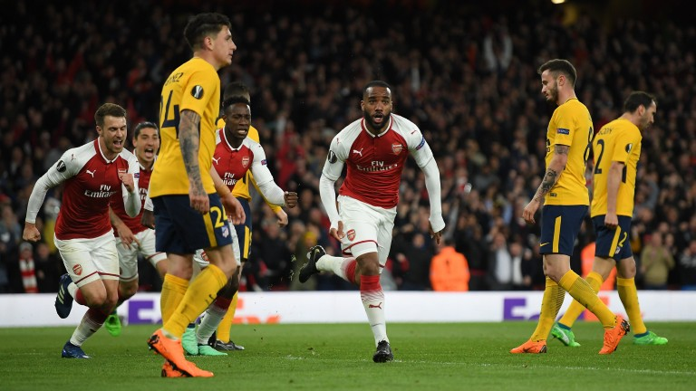 Alexandre Lacazette of Arsenal celebrates after scoring against Atletico Madrid