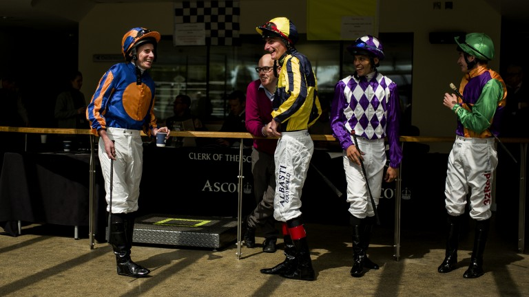 Ryan Moore and Adam Kirby share a joke before the opening race at Ascot