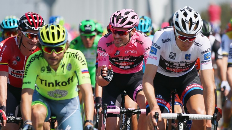 Defending champion Tom Dumoulin has a battle on his hands to hold onto the pink jersey