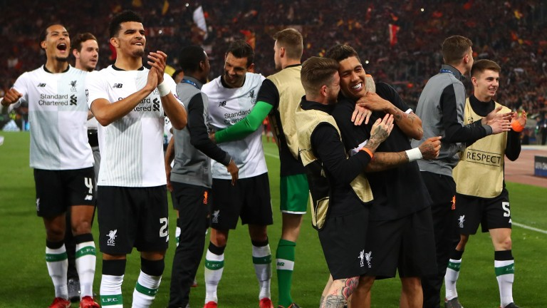 Liverpool celebrate after edging out Roma on aggregate to reach the Champions League final
