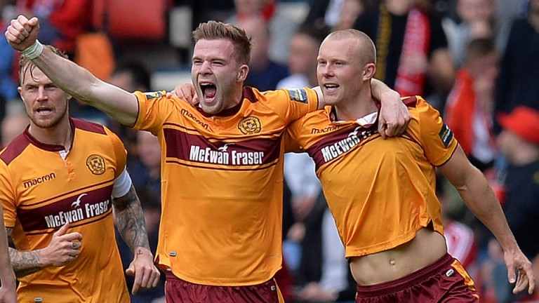 Motherwell's Curtis Main (right) celebrates a goal in the cup semi-final win over Aberdeen