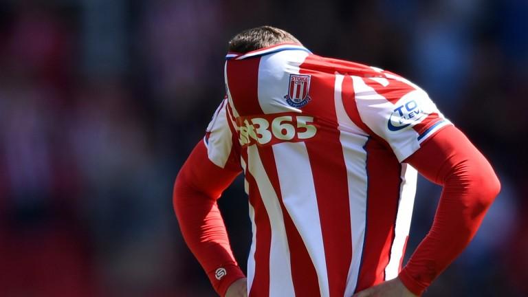 Stoke's Xherdan Shaqiri hides his face