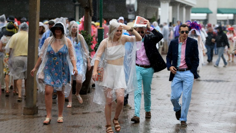 Racegoers in the rain: torrential downpours hit Churchill Downs on Kentucky Derby day