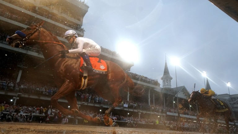 Justify (Mike Smith) claims the 144th Kentucky Derby beneath the lights and the Twin Spires at a murky Churchill Downs