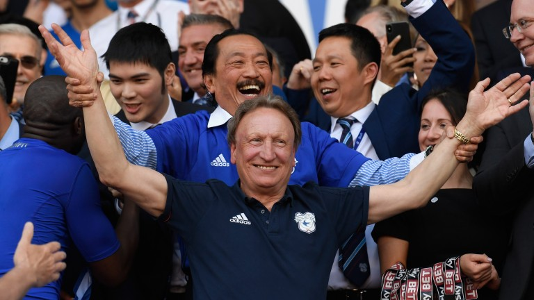 Cardiff owner Vincent Tan and manager Neil Warnock celebrate promotion