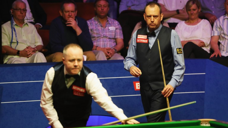 John Higgins (front) and Mark Williams in action on day one in Sheffield