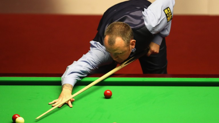 Mark Williams marches on in Sheffield on day two of the final