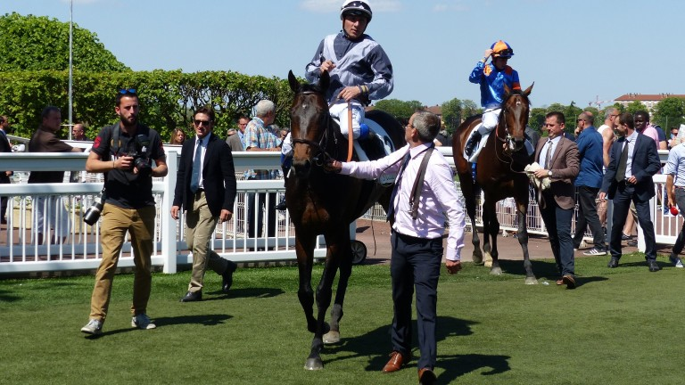Study Of Man and Stephane Pasquier return to the Saint-Cloud winners' enclosure after landing the Group 2 Prix Greffulhe