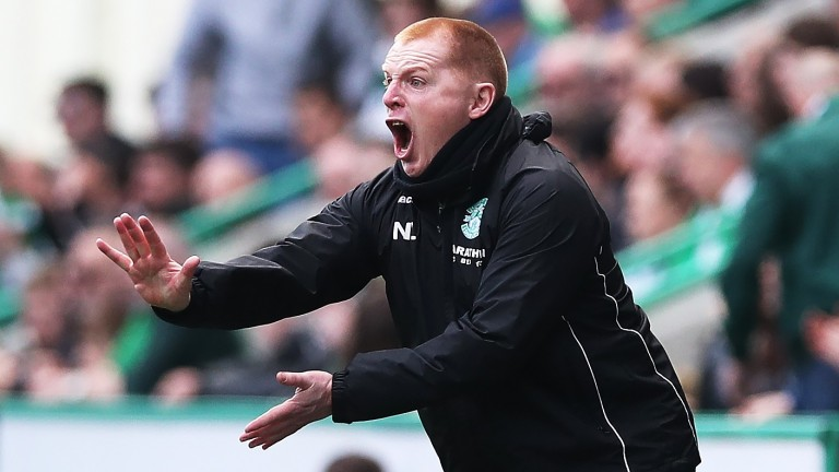 Hibernian manager Neil Lennon urges on his side against Celtic