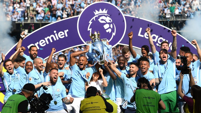 Manchester City get hold of the Premier League trophy after Sunday's game against Huddersfield