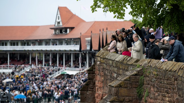 Vantage points: spectators line the city walls to get a view of the racing