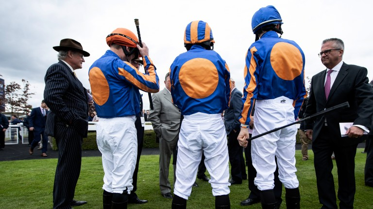 Ready to ride: Aidan O'Brien's team receive instructions before the Cheshire Oaks