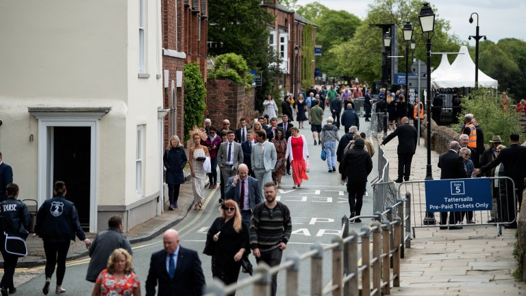 Here they come: racegoers make their way to the historic Roodee