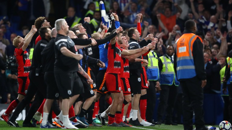 Huddersfield celebrate securing their Premier League status after their draw at Chelsea