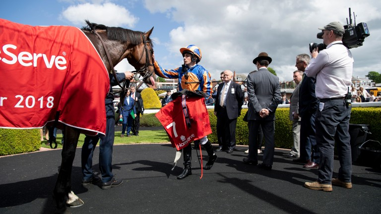 Ryan Moore gives Rostropovich a well-deserved pat after his Dee Stakes victory