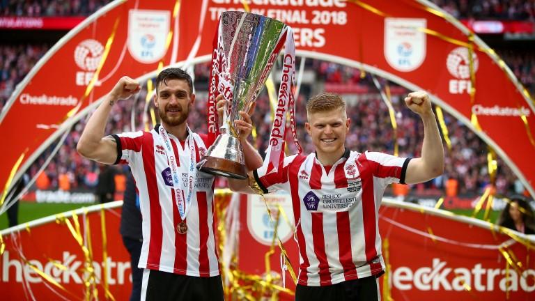 Luke Waterfall and Elliot Whitehouse celebrate Lincoln's victory in the EFL Trophy final