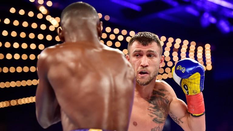 Vasyl Lomachenko (right) punches Guillermo Rigondeaux