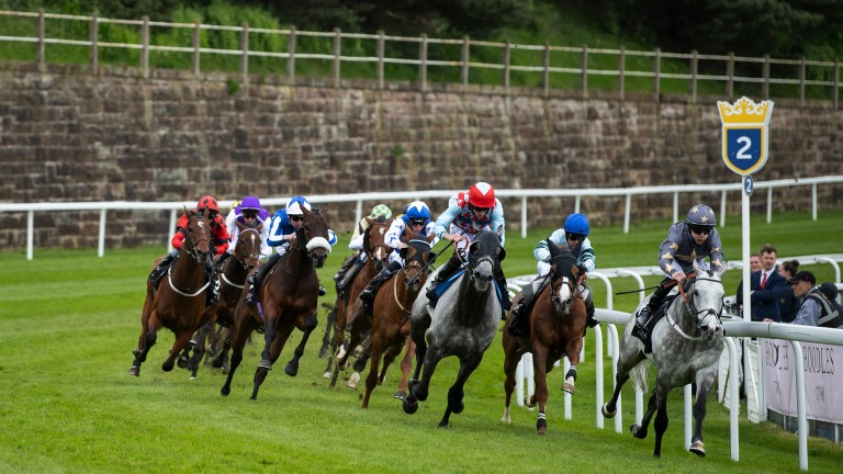 Restorer leads at the two furlong mark before stretching clear to win at Chester