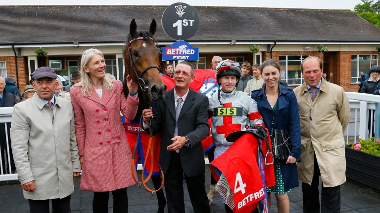 Knight To Behold and connections celebrate victory in the Lingfield Derby Trial