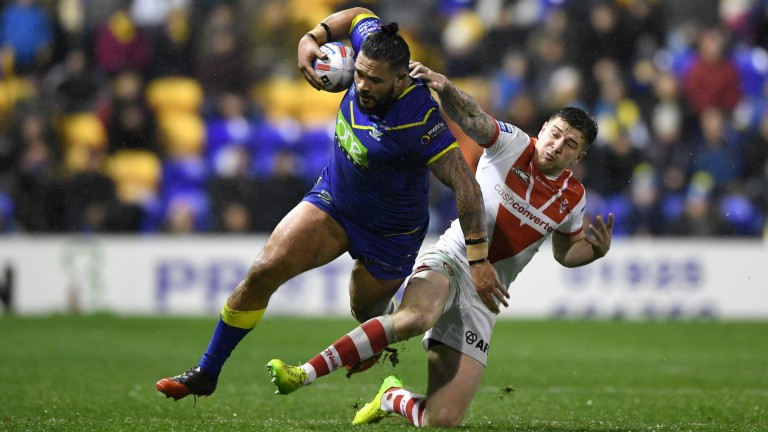 Warrington's Ben Murdoch-Masila (left) goes on the charge against St Helens