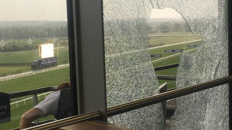 A smashed window at Ascot on Saturday as a result of fighting (picture credit: Annabel Whitchurch)
