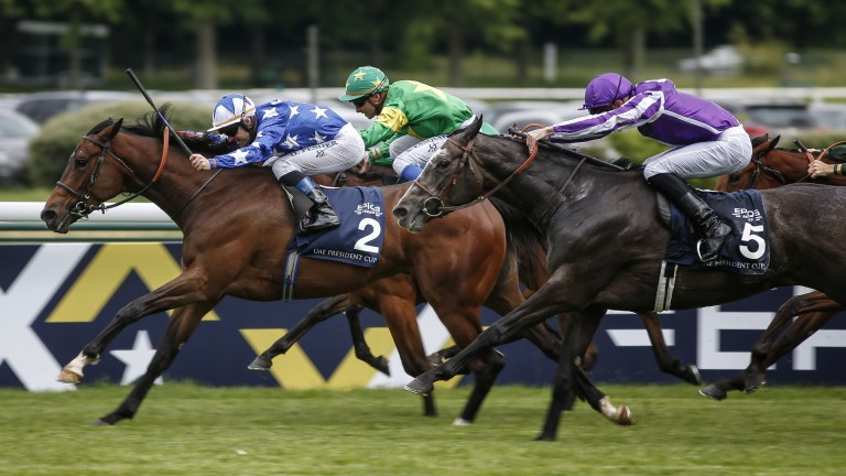 Teppal (2) en route to victory in the Emirates Poule d'Essai des Pouliches at Longchamp