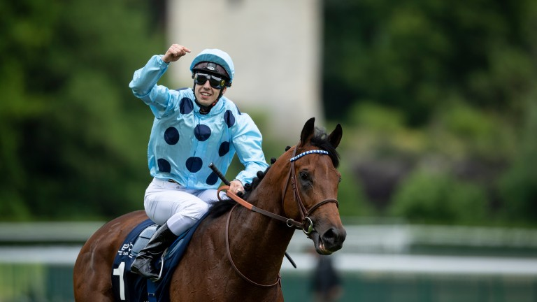 Familar salute: Cristian Demuro celebrates after lifting the Emirates Poule d'Essai des Poulians on Olmedo at Longchamp on Sunday