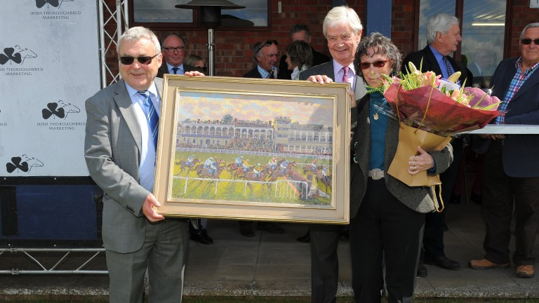 Bob Davies (left) and wife Dorcas receive a painting from Ludlow chairman William Jenks