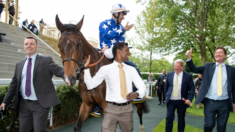 Teppal returns to the winner's enclosure after Classic victory at Longchamp
